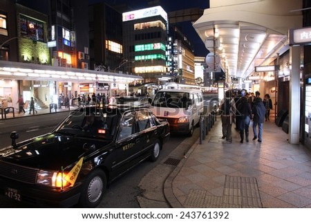 KYOTO, JAPAN - APRIL 16, 2012: Visitors shop at Shijo Street in Kyoto. With famous Marui and Takashimaya department stores Shijo is the best shopping area in Kyoto (according to Japan Guide).