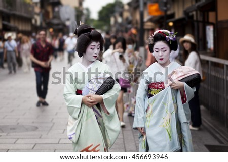 KYOTO,JAPAN- CIRCA MAY, 2016: Maiko geisha walking on a street of Gion in Kyoto Japan