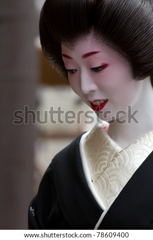 """KYOTO, JAPAN - JUNE 5:geisha on """"houjoue"""" event stands on the famous Shirakawa street in the Gion district on June 5: , 2011 in Kyoto, Japan. Maiko is the title given to an apprentice Geisha. - stock photo"""