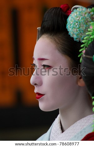 """KYOTO, JAPAN - JUNE 5: Unidentified Maiko on """"houjoue"""" event stands on the famous Shirakawa street in the Gion district on June 5: , 2011 in Kyoto, Japan. Maiko is the title given to Geisha. - stock photo"""