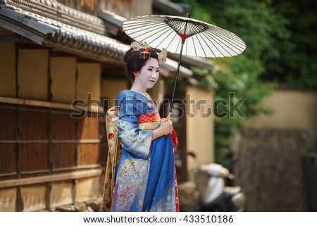 KYOTO, JAPAN - JUNE 10: Unidentified woman dress like a Maiko, Japanese women usually makeup as Geishas (also known as Maiko) for a walk in Kyoto on June 10, 2015 in Japan - stock photo