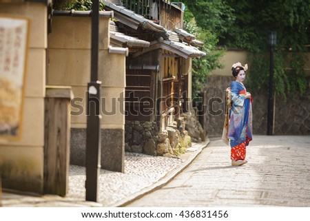 KYOTO, JAPAN - JUNE 10: Unidentified woman dress like a Maiko, Japanese women usually makeup as Geishas (also known as Maiko) for a walk in Kyoto on June 10, 2015 in Japan