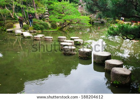 KYOTO, JAPAN - March 27, 2014: A stone path in the Zen Garden of the Heian-jingu Shrine on March 27, 2014 in Kyoto, Japan. Heian-jingu Shrine is listed as an important cultural property of Japan.  - stock photo