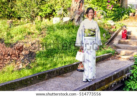 Kyoto, Japan - May 01, 2014: View of a Japanese girl wearing traditional Kimono. The kimono is a Japanese traditional garment and is always used in important festival or formal moments