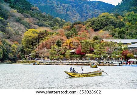 KYOTO, JAPAN - Nov 26: Tourists visit Arashiyama in autumn season by boat on November 26, 2015. - stock photo