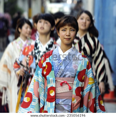 "KYOTO,JAPAN-NOVEMBER 3, 2014; A group of ""one day geisha"" Japanese girls,walking in a very traditional area. November 3,2014 Kyoto,Japan - stock photo"