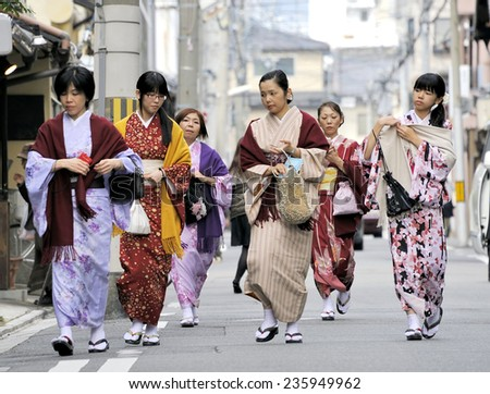 "KYOTO,JAPAN-NOVEMBER 8, 2014; A group of ""one day geisha"" Japanese women walking in a very traditional area of the city. November 8,2014 Kyoto,Japan - stock photo"