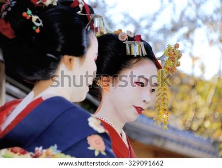 KYOTO,JAPAN - NOVEMBER 4, 2014: Geisha woman in traditional dress. Kyoto is center of Japan's traditional culture. arts. November 4, 2014 Kyoto, Japan. - stock photo