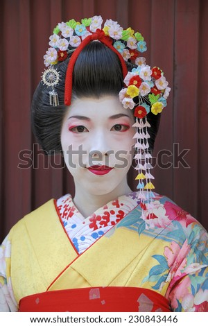 KYOTO,JAPAN - NOVEMBER 4, 2014: Geisha woman in traditional dress.  They are called 'maiko' in Kyoto and are skilled entertainers and study traditional Japanese arts. November 4, 2014 Kyoto, Japan. - stock photo