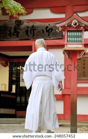 KYOTO, JAPAN-NOVEMBER 6, 2014;Monk at Fushimi Inari Taisha Shrine  in Kyoto, Japan. This is an Unesco World Heritage site.November 6, 2014 Kyoto, Japan - stock photo