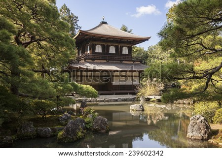 KYOTO, JAPAN - NOVEMBER 4, 2013: The Silver Pavilion, or Ginkakuji, in the Joshoji complex in Kyoto, Japan is a traditional pavilion looking out over the garden and ponds as seen on November 4, 2013.  - stock photo