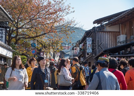 Kyoto, Japan - November 6, 2015: Tourists walk on a street around Kiyomizu Temple. Kiyomizu is a famous temple in Kyoto built in year 778. The temple is part of the Historic Monuments of Ancient Kyoto