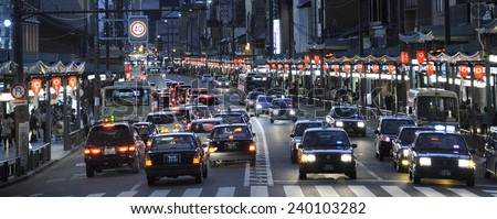 KYOTO,JAPAN-NOVEMBER 3, 2014; Typical panorama view of busy street in central of the town at night. November 3, 2014 Kyoto, Japan. - stock photo