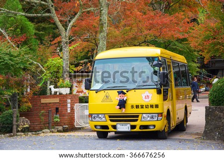 KYOTO, JAPAN - NOVEMBER 13, 2015: Unidentified children in cute school bus on the way to send students back from school. - stock photo