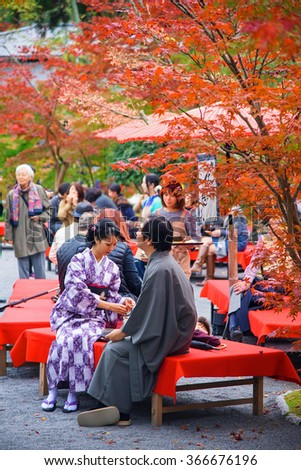 KYOTO, JAPAN - NOVEMBER 13, 2015: Unidentified couple with Traditional Japanese Kimono dress at Eikando temple or Zenrinji. Here is located in northern Kyoto and famous during fall colors in Autumn. - stock photo