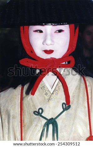 Kyoto, Japan - October 1987 - Japanese woman in costume and makeup for the Jidai Matsuri festival - stock photo