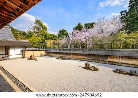 Kyoto, Japan the Ryoan-ji Temple zen rock garden in the spring. - stock photo