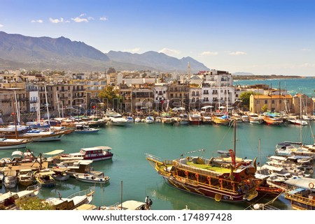 KYRENIA, CYPRUS - OCTOBER 6, 2013 - Scenic view of a busy historic harbour and the old town in Kyrenia (Girne) on the Island of Cyprus.