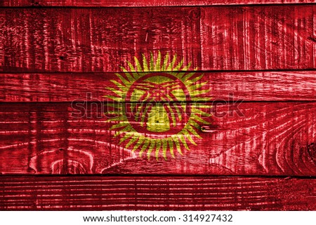 Kyrgyzstan Flag on old wood texture background - old wood background