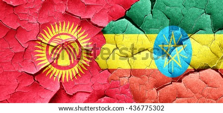 Kyrgyzstan flag with Ethiopia flag on a grunge cracked wall - stock photo