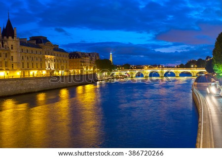 La Conciergerie  and Pont Neuf over river Seine at night, Paris, France - stock photo