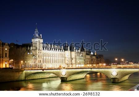 la conciergerie at night with pont de l'horloge in foreground, paris, france - stock photo