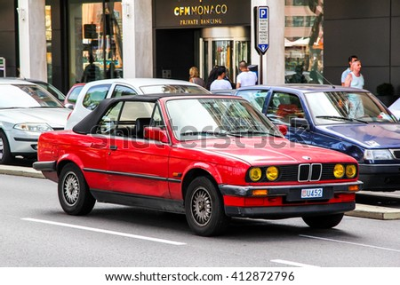 LA CONDAMINE, MONACO - AUGUST 2, 2014: Motor car BMW E30 3-series in the city street. - stock photo