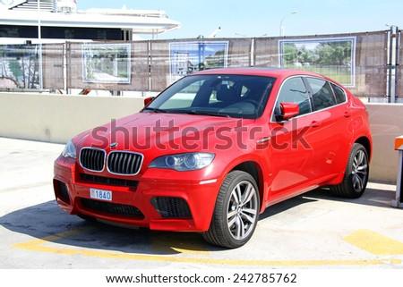 LA CONDAMINE, MONACO - AUGUST 2, 2014: Red luxury crossover BMW E71 X6M at the city pier. - stock photo