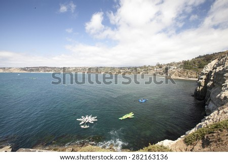 La Jolla Cove view of Kayaking in ocean waters and coastal shores - stock photo