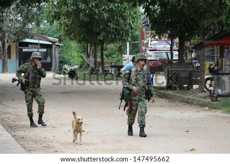 LA MACARENA, COLOMBIA-NOVEMBER 8: Military forces of Colombia supervise territories where guerrillas of FARC still act. Soldiers patrol the city in November 8; 2012 in La Macarena; Colombia