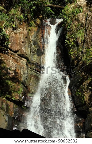 La Mina Falls in the El Yunque rainforest in the Caribbean National Forest, Puerto Rico - stock photo