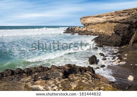 La Pared volcanic beach on Fuerteventura west coast, Canary Islands, Spain, with eroded landscape and black sand. - stock photo