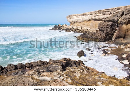 La Pared volcanic beach or Playa de La Pared on Fuerteventura south west coast, Canary Islands, Spain, with eroded landscape and black sand. - stock photo