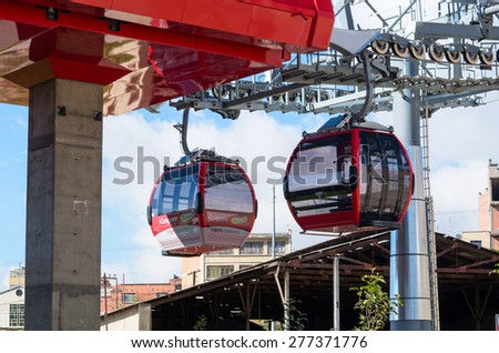 LA PAZ, BOLIVIA - APR 03, 2015: Cable cars carry passengers in La Paz. Aerial cable car of urban transit system opened in 2014 in the Bolivian city of La Paz.