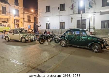 LA PAZ, BOLIVIA - APRIL 28, 2015: Classic Volkswagen Beetles parked in a center of La Paz, Bolivia - stock photo