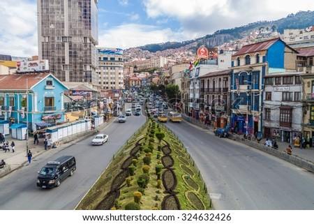 LA PAZ, BOLIVIA - APRIL 23, 2015: Traffic on a main road Avenida Ismael Montes in La Paz, Bolivia. - stock photo