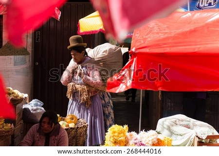 LA PAZ, BOLIVIA March 21, 2015: a lady wearing traditional clothes in a market - stock photo