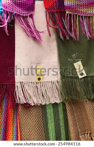 LA PAZ, BOLIVIA - NOVEMBER 10, 2014: Alpaca scarves hanging at a shop on Linares street in the city center on November 10, 2014 in La Paz, Bolivia - stock photo