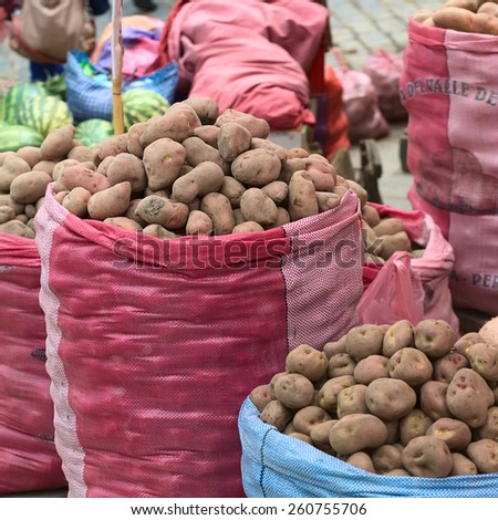 LA PAZ, BOLIVIA - NOVEMBER 10, 2014: Sacks of potatoes being sold on the roadside along Zoilo Flores street in the city center on November 10, 2014 in La Paz, Bolivia - stock photo
