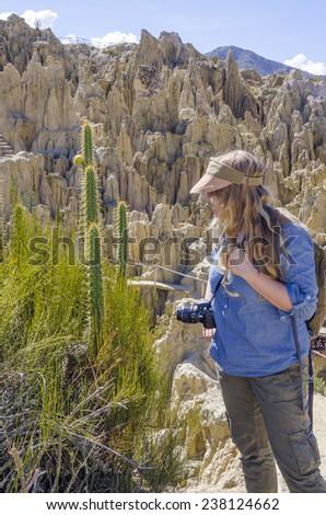 La Paz, Bolivia - Young blond tourist visiting Valle de la Luna (Moon Valley) - stock photo