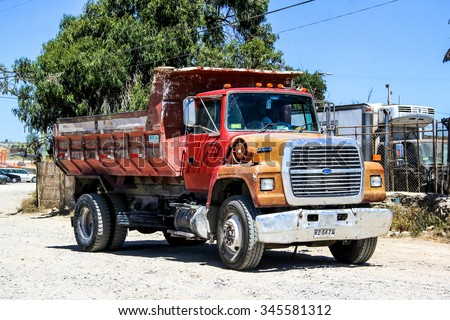 LA SERENA, CHILE - NOVEMBER 19, 2015: Dump truck Ford L8000 at the town street. - stock photo