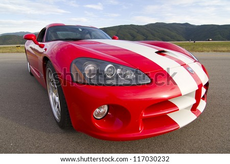 LA SEU D'URGELL, SPAIN - OCTOBER 6: A Dodge Viper SRT take part in Road and Track racing weekend organizated by American Car Club, on October 6, 2012, in the airport of La Seu d'Urgell, Spain. - stock photo