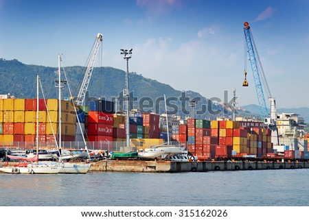 LA SPEZIA, ITALY - AUGUST 08, 2015: Cargo port with containers and cranes in La Spezia in Liguria province, Italy.