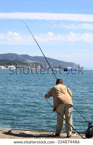 La Spezia, Italy September 18, 2015: fisherman fishing with rod fixed in the port of La Spezia
