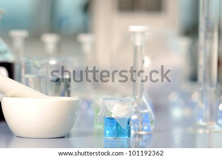 Lab flasks and grinding pestle - stock photo