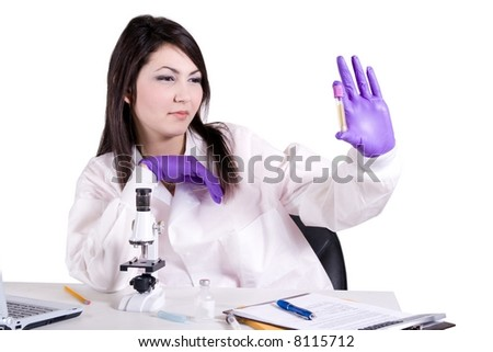 Lab tech working with specimen - stock photo