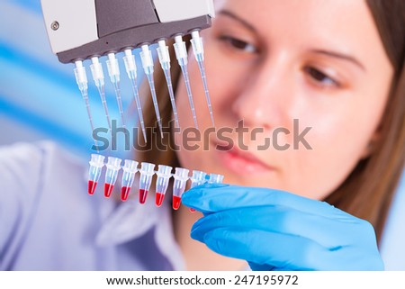 Lab with a pipette in a medical lab - stock photo