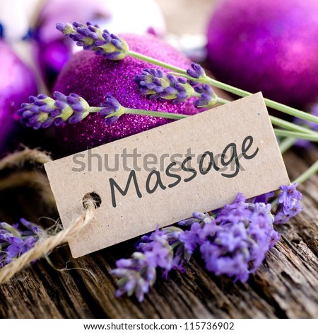 Label and fresh lavender on wooden ground - stock photo