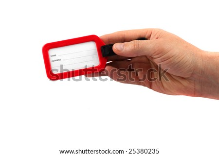 Label in a hand on a white background