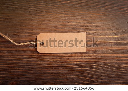 label note on old wood background with copy space - stock photo